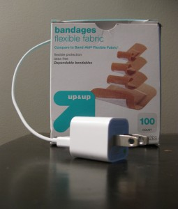 phone charger in a box of bandages